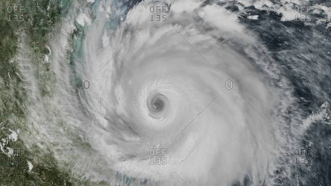 Hurricane making landfall seen from space, CGI reconstruction incorporating NASA imagery.