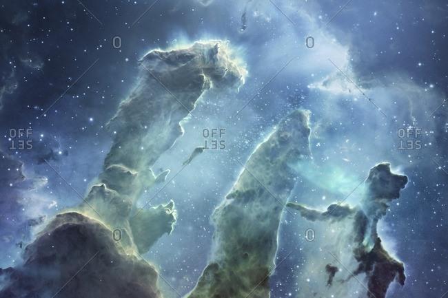 Eagle nebula with the Pillars of Creation. Illustration based on Hubble Space Telescope imagery.