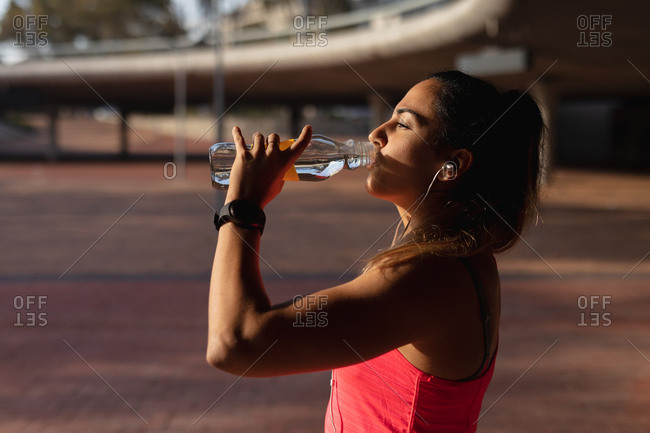 Woman drinking water during workout