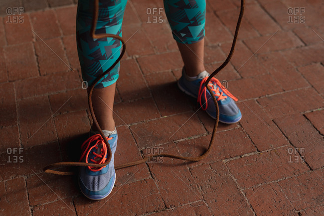 Woman exercising in a park with skipping rope