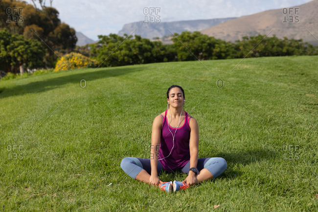 Woman exercising in a park