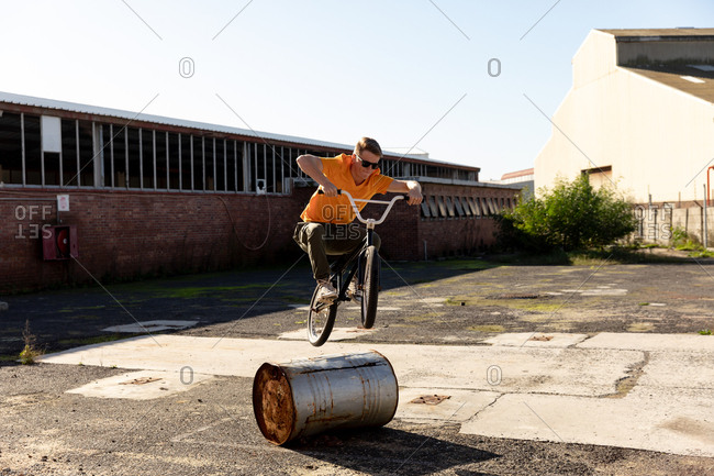 BMX rider jumping in an empty yard