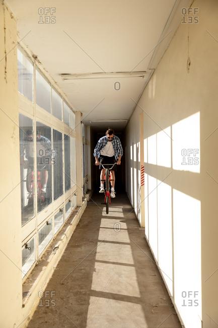 BMX rider in a corridor jumping