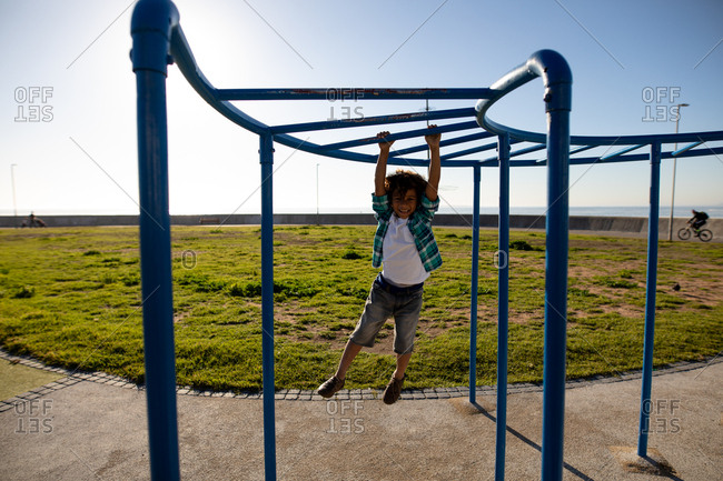 Boy enjoying a day out on playground