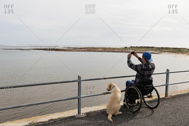 Disabled man in a wheelchair enjoying a day out