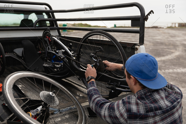 Disabled man in a wheelchair assembling a bike