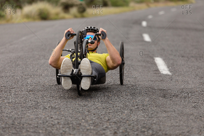 Man cycling on recumbent bicycle