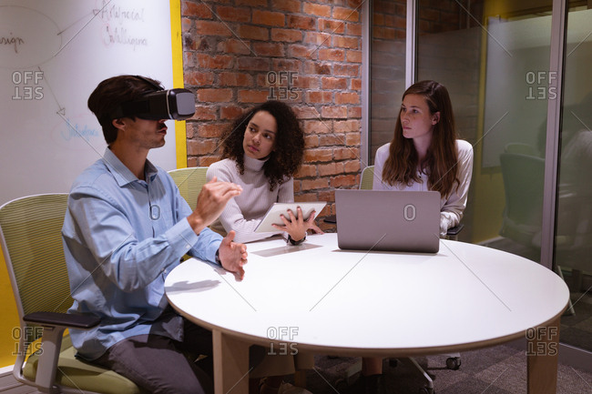 Young business creatives working with VR in an office