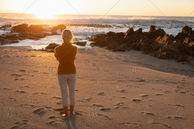 Woman enjoying time by the sea
