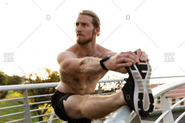 Man exercising on a footbridge