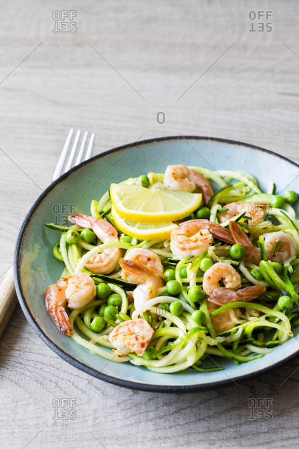 Zucchini noodles tossed with lemon chili shrimp and peas for an easy low carb dinner