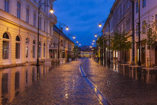 January 3, 2016: Wet street at sunset in Sibiu, Romania