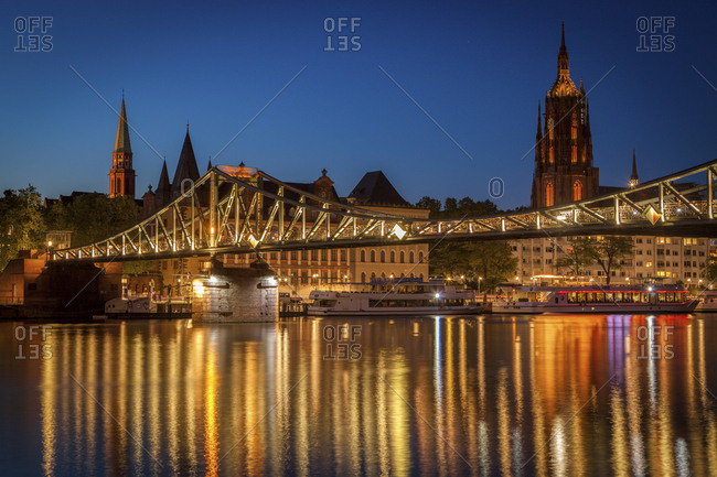 January 3, 2016: Bridge over river at sunset in Frankfurt, Germany