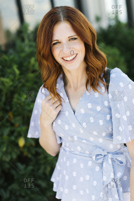 Smiling mid adult woman wearing patterned blouse