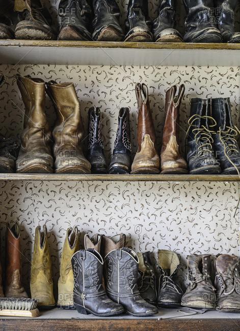 Shelves of cowboy boots - Offset