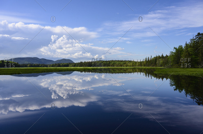 Clouds reflected in lake in Acadia National Park, USA