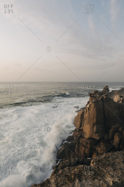 Cliff by sea at sunset in Peniche, Portugal