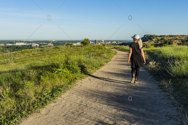 Mature woman hiking by grass in Boise, Idaho, USA