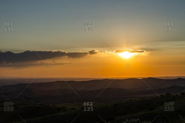 Sunset cloudscape over hills