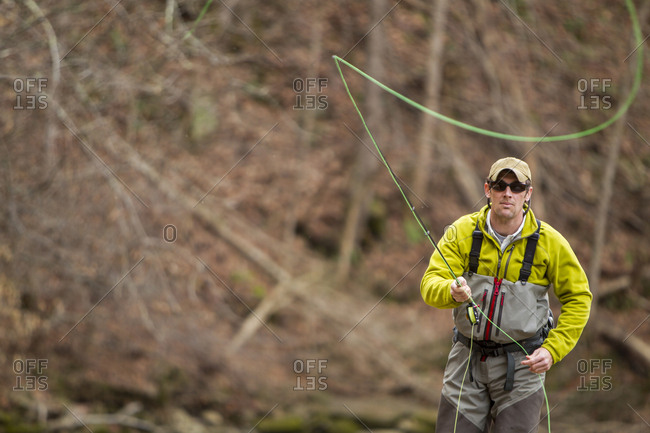 Young man fly-fishing