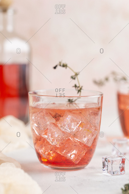 Pink cocktail with ice cubes