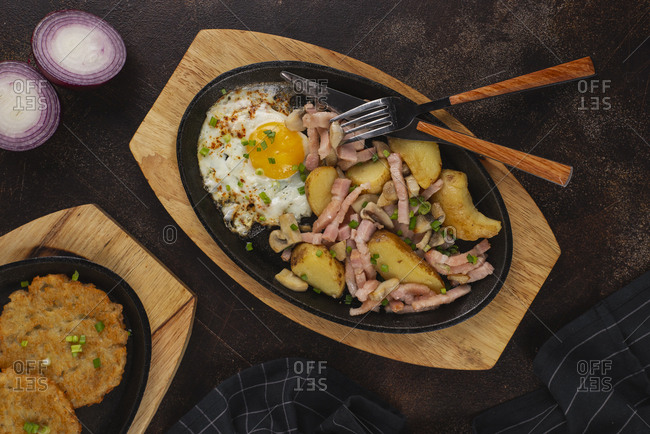 Dish of potatoes, ham and fried egg