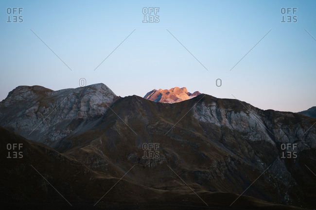Alpenglow on Vignemale during sunrise in Pyrenees in France