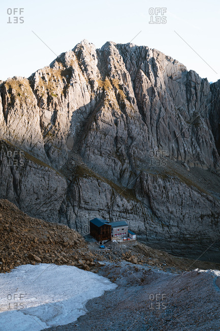 Old and new mountain hut under construction in high altitude in Pyrenees