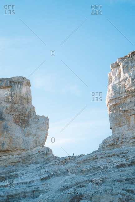 Hiker between two giant rock in Pyrenees in the border between France and Spain