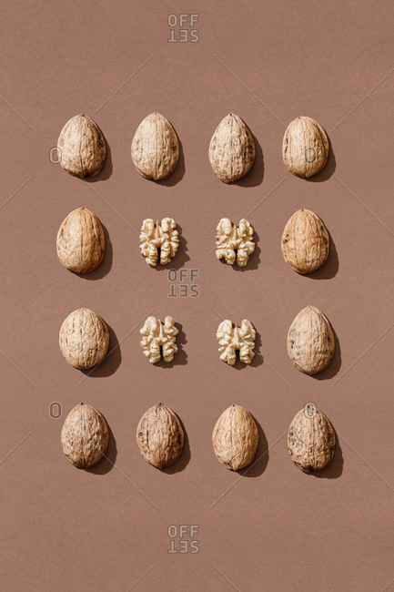orderly composition with nuts on brown background