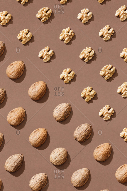 Pattern with walnuts on brown background