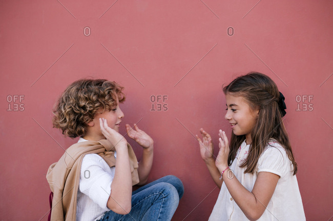 Boy and girl play clashing hands