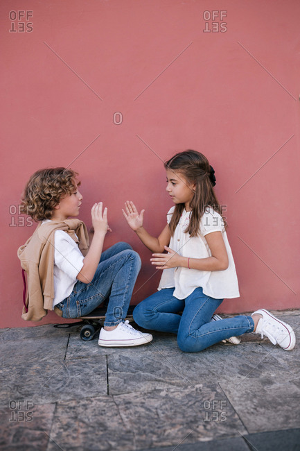 Boy and girl play game with their hands