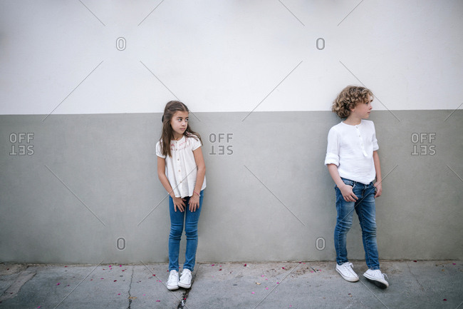 Young girl looking over angrily at her brother