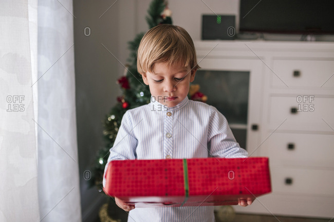 Caucasian boy with Christmas gift in hands