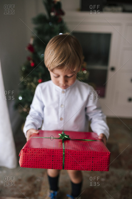Young boy with Christmas gift in hands