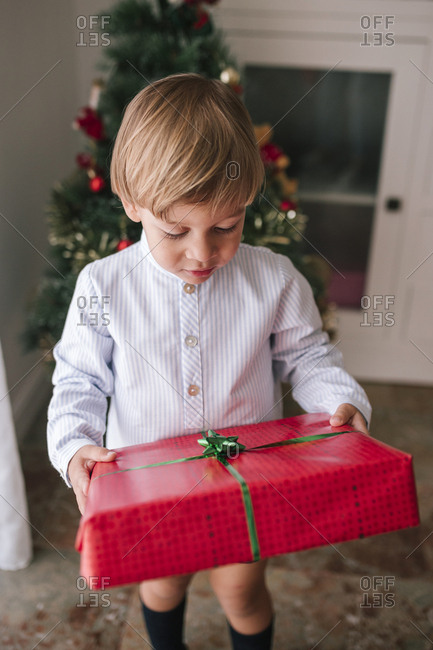 Little boy with Christmas gift in hands