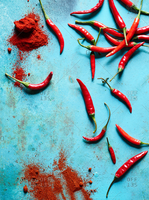 Asian chili peppers on light blue background