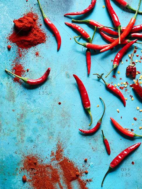 Overhead view of Asian chili peppers on light blue background