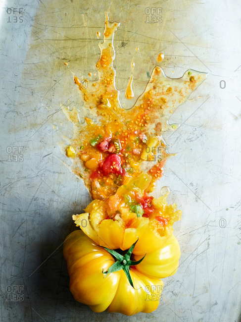 Splattered tomato with colorful pieces from various tomatoes