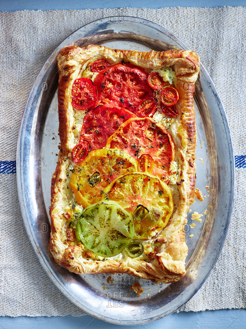 Tart pizza with colorful heirloom tomatoes