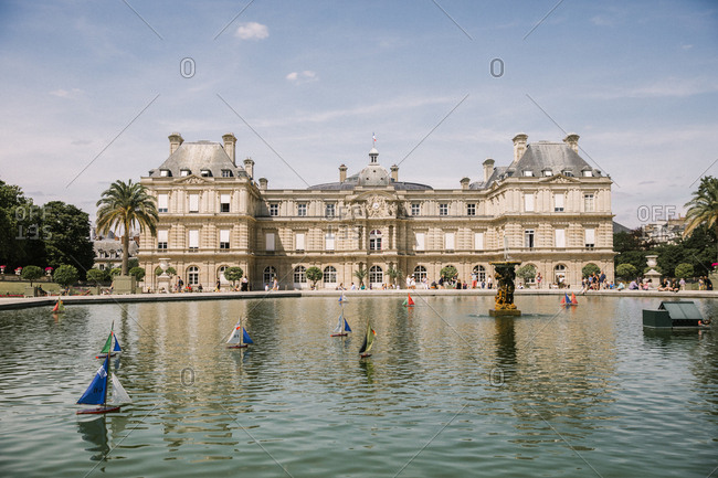 July 8, 2019: A fountain full of colorful boats in front of Luxembourg Palace in Paris, France
