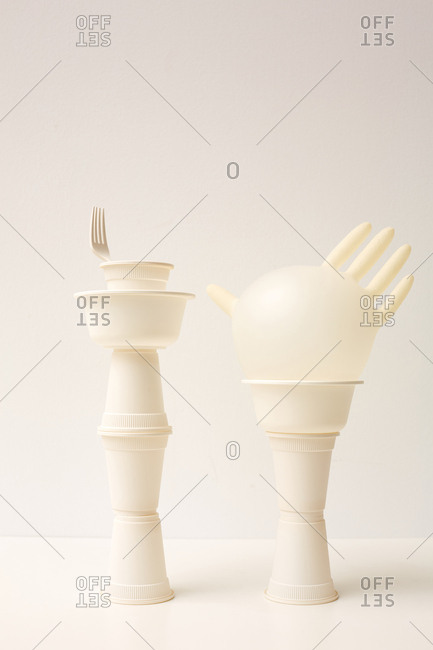 Two white towers made out from plastic dishes and latex glove art object