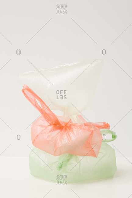 Transparent white, peach and green plastic bags inflated odd installation