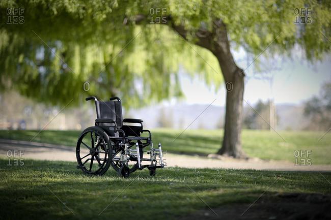 Empty wheelchair in a park.