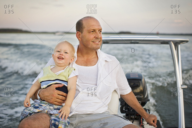 Father and baby son on a boat
