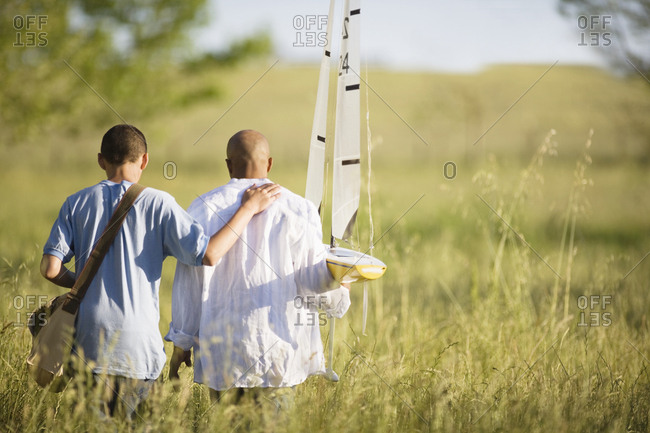Father and son with a toy sailboat