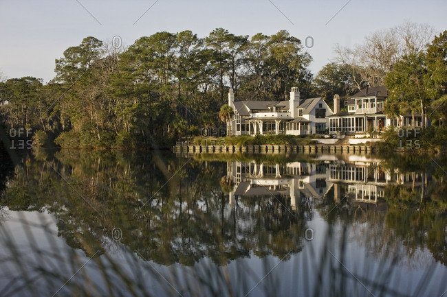 House reflected in placid lake