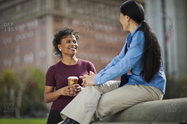 Happy mid adult woman talking while on a lunch break.