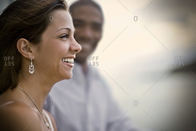 Smiling young woman standing next to her partner.